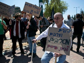 A draft-dodging demonstration in front of a recruitment station near Tel Aviv.