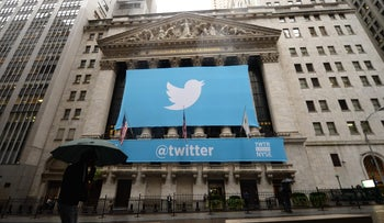 A banner with the logo of Twitter  on the front of the New York Stock Exchange (NYSE) in New York.