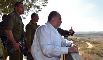 Defense Minister Avigdor Lieberman visits an Israeli army unit on a high point overlooking the Gaza Strip, July 2016.