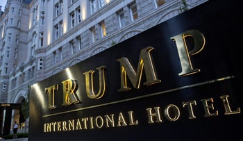 Signage stands outside the Trump International Hotel, formerly the Old Post Office Pavilion, in Washington, D.C., U.S., on Friday, Sept. 16, 2016.