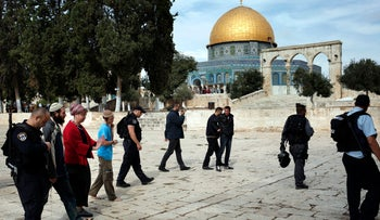Three Jewish worshipers, escorted by Israeli security forces, visit the Temple Mount, October 28, 2015.