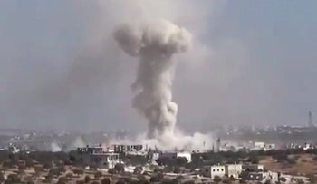 This frame grab from a video of the Revolutionary Forces of Syria shows smoke rising after an airstrike on the village of Hass, Syria, October 26, 2016.