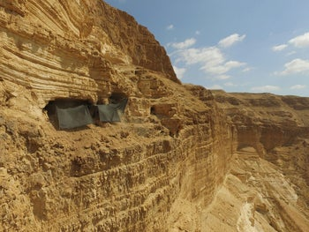 """The Cave of Skulls in the Judean Desert .Israel Hasson, director of the Israel Antiquities Authority: """"Every day robbers go into the desert in order to search out and plunder ancient documents such as the papyrus that was exposed."""""""