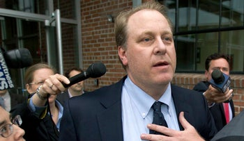 In this May 16, 2012, file photo, former Boston Red Sox pitcher Curt Schilling is with members of the media at the Rhode Island Economic Development Corporation headquarters, in Providence, R.I.
