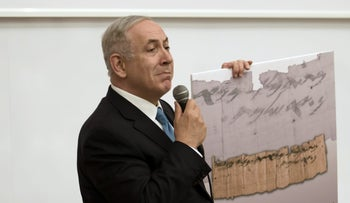 Netanyahu displays the papyrus: 'A postcard from the past to UNESCO.'