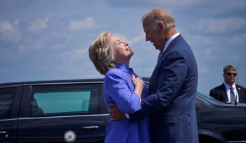 Democratic presidential nominee Hillary Clinton welcomes Vice President Joe Biden as he disembarks from Air Force Two for a joint campaign event in Scranton, Pennsylvania, August 15, 2016.