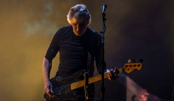 British singer Roger Waters play the bass during his performance at a free concert in Mexico City's Zocalo, Saturday, Oct 1, 2016.