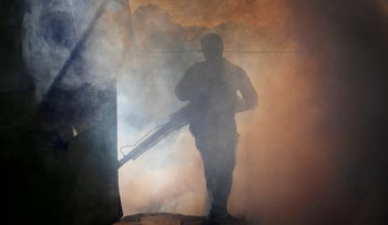 A health ministry worker fumigates a house to kill mosquitoes during a campaign against dengue and chikungunya and to prevent Zika infection in Managua, Nicaragua October 27,2016.