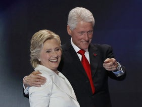 Democratic presidential nominee Hillary Clinton stands with her husband, former president Bill Clinton, after accepting the nomination on the final night of the Democratic National Convention in Philadelphia, Pennsylvania, U.S. July 28, 2016.