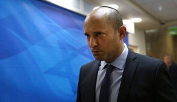 Israeli Education Minister Naftali Bennett arrives to the weekly cabinet meeting at the prime minister's office in Jerusalem, Sunday, Oct. 9, 2016.