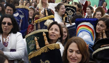 Members of Women of the Wall carry a Torah scroll after prayers in the women's section of the Western Wall in Jerusalem, November 2, 2016.