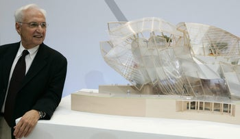 Architect Frank Gehry stands by a model of his work in Paris.