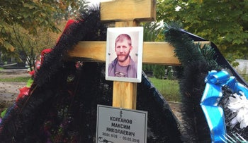 A portrait of Russian contractor Maxim Kolganov, who was killed in combat in Syria, is pictured on a grave in his hometown of Togliatti, Russia, September 29, 2016. Picture taken September 29, 2016.