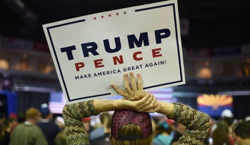 A supporter awaits the start of a campaign rally by Republican presidential candidate Donald Trump at the Prescott Valley Event Center, October 4, 2016 in Prescott Valley, Arizona.