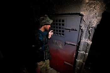 An Iraqi security forces member inspects a building that was used as a prison by Islamic State militants in Hammam al-Alil, Iraq, November 7, 2016.