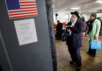 An ultra-Orthodox man waits his turn to vote in the presidential election in the Crown Heights section of New York, Tuesday, Nov. 4, 2008.