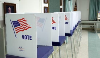 Voting booths set up and ready to receive voters inside a polling station in Christmas, Florida on November 8, 2016.