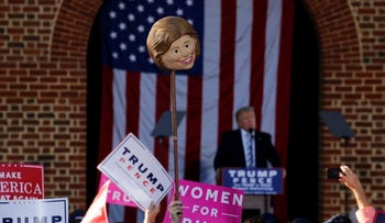 A Trump rally in Virginia, at which a supporter held aloft a mask of rival Hillary Clinton, Oct. 22, 2016.