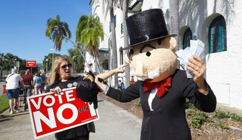 Opponents of ammendment one in Florida protest outside of the polls during the U.S. presidential election in St. Petersburg, Florida, U.S. November 8, 2016.