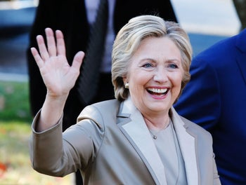 Democratic presidential nominee Hillary Clinton greets supporters after casting her vote in Chappaqua, New York on November 8, 2016.