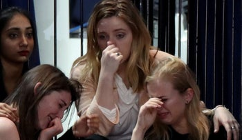 A group of women react as voting results come in at Hillary Clinton's election night event at the Jacob K. Javits Convention Center November 8, 2016 in New York City