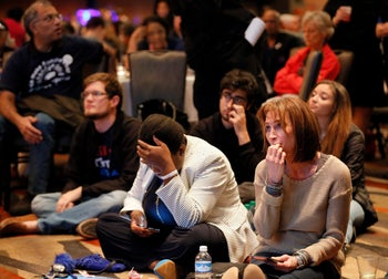 Attendees watch returns on nearby video screens during the Dallas County Democrats watch party.