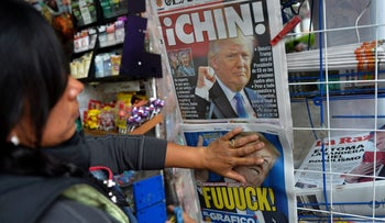 A newspaper rack with headlines about Donald Trump's victory, Mexico City, November 9, 2016.