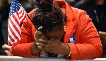 Clinton supporter Marta Lunez reacts to elections results during at the Jacob K. Javits Convention Center in New York, November 8, 2016.