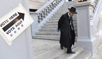 A voter leaves the East Midwood Jewish Center polling station after casting his ballot in the presidential election in the Brooklyn borough of New York City on November 8, 2016.