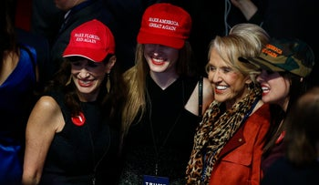 "Women wearing ""Make America Great Again"" attend an election night party for Donald Trump at the Hilton Midtown hotel in New York, November 8, 2016."