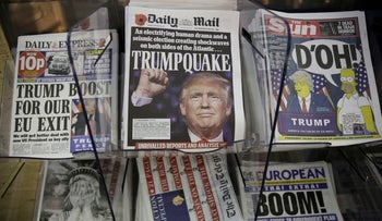 Newspaper front pages reporting on President-elect Donald Trump winning the American election are displayed for sale outside a store in London on November 10, 2016.