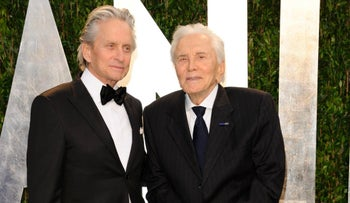 In this Feb. 26, 2012 file photo, Michae l Douglas, left, and Kirk Douglas arrive at the Vanity Fair Oscar party in West Hollywood, Calif.