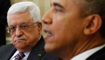 FILE PHOTO: U.S. President Barack Obama meets with Palestinian Authority President Mahmoud Abbas. March 17, 2014.
