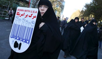 An Iranian demonstrator holding an anti-U.S. placard in a rally in front of the former U.S. Embassy in Tehran, Iran, on November 3, 2016.