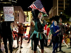 Demonstrators walk through downtown San Diego in protest of Donald Trump's election as the president of the United States, San Diego, California, U.S. November 9, 2016.