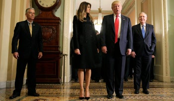 U.S. President-elect Donald Trump (2ndR) answers questions as his wife Melania Trump and Senate Majority Leader Mitch McConnell (R-KY) watch on Capitol Hill in Washington, U.S., November 10, 2016.