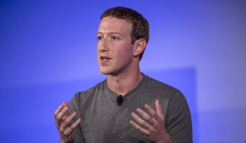 Mark Zuckerberg gestures as he speaks during a session at the Techonomy 2016 conference in Half Moon Bay, California, U.S., on Thursday, Nov. 10, 2016.