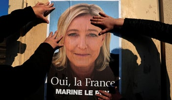 A poster supporting National Front leader Marine Le Pen, Frejus, France March 18, 2014.