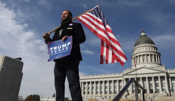 A Trump supporter waits for anti-Trump demonstrators at the Utah State Capitol building in Salt Lake City, November 12, 2016.