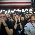 Supporters of Democratic presidential nominee Hillary Clinton watch and wait at her election night rally in New York, New York, November 8, 2016.