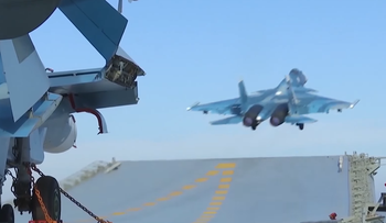 A Russian fighter jet takes off the Admiral Kuznetsov aircraft carrier.