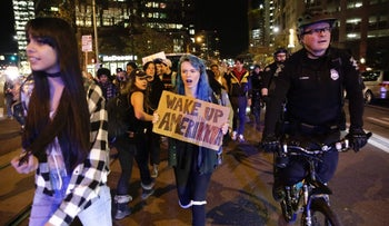 People march in protest against US President-elect Donald Trump in Seattle, Washington, November 14, 2016.