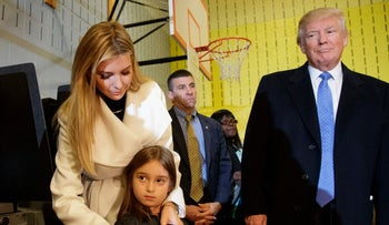 "Republican presidential candidate Donald Trump watches as his daughter Ivanka puts an ""I Voted"" sticker on her daughter Arabella, after casting their ballots at PS-59, Tuesday, Nov. 8, 2016, in New York."