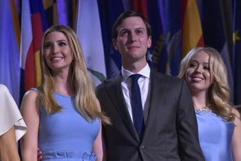 Ivanka Trump, her husband Jared Kushner and Tiffany Trump smile as Republican presidential elect Donald Trump speaks during election night at the New York Hilton Midtown in New York on November 9, 2016.