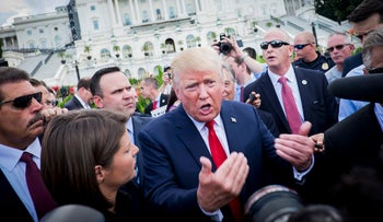 Donald Trump, president-elect, talks to the media during a Tea Party Patriots rally against the Iran nuclear deal on Capitol Hill in Washington, D.C., U.S., on Wednesday, Sept. 9, 2015.