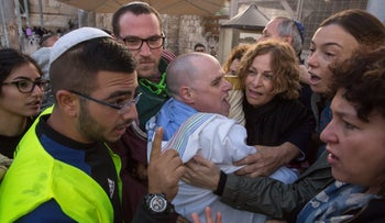 Rabbis at the march at the Western Wall being held back by an usher, November 3, 2016.