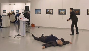 Russia's ambassador to Turkey lies on the floor after being shot by a gunman at an art gallery in Ankara, Turkey, December 19, 2016.