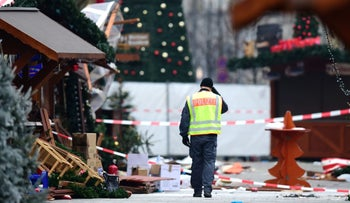 A policeman walks at the Christmas market where a terror attack took place a day earlier, Berlin, Germany, December 20, 2016.