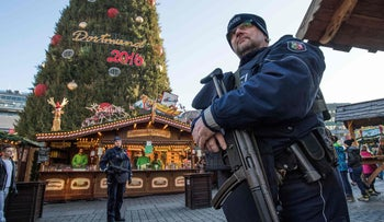 Policemen patrol over a Christmas market in Dortmund as security measures are taken after a deadly attack ravaged a Berlin Christmas market a day earlier, December 20, 2016.