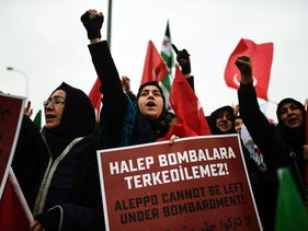Protesters shout slogans and hold placards in support of Aleppo in Hatay near Turkey's border with Syria, December 17, 2016.